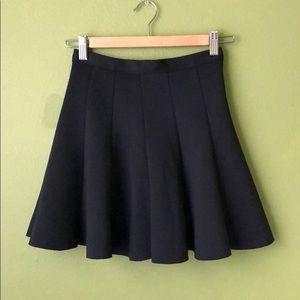 Black high waisted pleated skirt